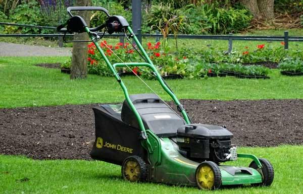 Green rolling lawnmower